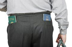 Stock Photo of businessman has israeli and tonga passports in his rear pockets