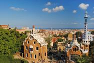 Stock Photo of modern buildings at the entrance to park guell in barcelona, spain