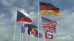 Stock Video Footage of Flags flying outside the Mémorial de Caen (Caen Memorial), Normandy, France.