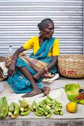 indian women selling greengrocery at street market - stock photo