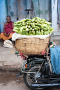indian men selling greengrocery at street market - stock photo