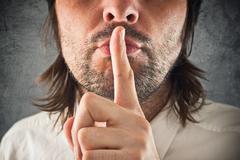 Businessman making hush gesture - stock photo