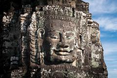 buddha faces of bayon temple at angkor wat complex, siem reap, cambodia - stock photo