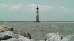 Lighthouse in ocean Stock Footage