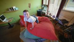 Little boy on top of huge pillows Stock Footage