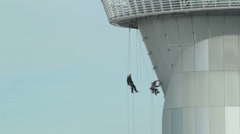Aerial workers on an airport tower Stock Footage