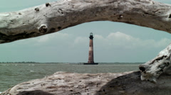 Through driftwood to lighthouse Stock Footage
