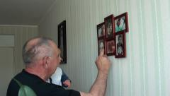 Grandpa shows grandson family photoes Stock Footage