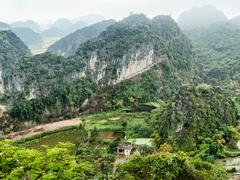 Panorama view of vietnamese village among rice fields and limestone Stock Photos