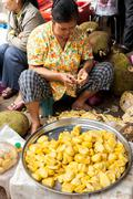 Khmer woman selling jackfruit at traditional food marketplace Stock Photos