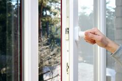 hand open plastic pvc window - stock photo