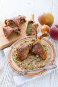 Roasted goose thighs with grits Stock Photos