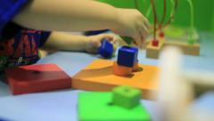 A Toddler Child Plays with Colorful Block Shapes 3 of 8 Stock Footage