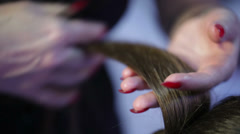 Hairdresser using comb hair hair divides Stock Footage