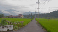 Beautiful yilan houses with mountain and grass Stock Footage