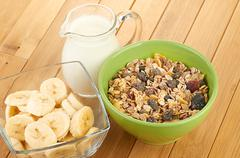 Plate with raw oatmeal on wooden table. Stock Photos