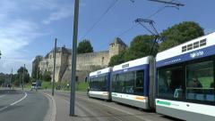 Electric tram passes in front of the Château de Caen, Caen, France. Stock Footage
