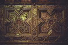 wood paneling covered with gold leaf - stock photo