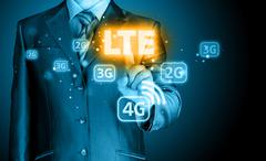 businessman is pushing his finger on lte button - stock illustration