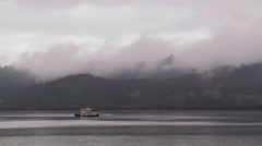 Rain and mist 2 over boat on  harbour Stock Footage