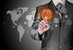 Businessman pushing shopping cart - stock illustration