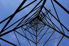 Up view inhigh-tension transmission line Stock Photos