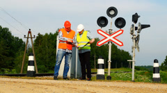 Railroad workers with folders near signal beacons episode 4 Stock Footage
