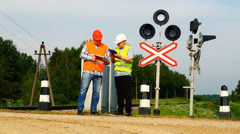 Railroad workers with folders near signal beacons episode 5 Stock Footage