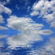 Seascape with blue sky and white clouds Stock Photos