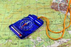Blue compass and map Stock Photos