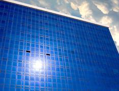 Sun reflection on facade modern building Stock Photos