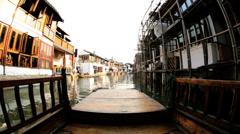 POV river boating Zhujiajiao water village waterways Shanghai China - stock footage