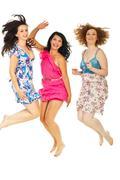 Cheerful women jumping togheter - stock photo