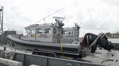 USAV New Orleans delivers small boats to Tradewinds Stock Footage