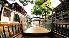POV boating Zhujiajiao water village riverside homes Shanghai - stock footage