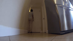 4K Woman opens pantry and looks in-fisheye view Stock Footage