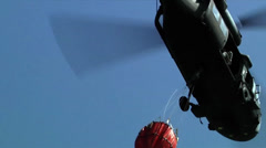 Fire training helicopters with Bambi Bucket Training Stock Footage