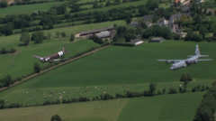 C-47 Dakota skytrain and C-130 Hercules Normandy Formation Stock Footage