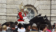 Stock Video Footage of London Spectators gather in front of the Queen's Royal Horse guards