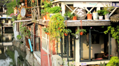 Motion panning Zhujiajiao water village riverside homes Shanghai China - stock footage