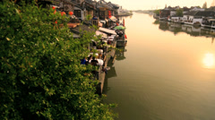 Motion panning Sunset Zhujiajiao water village Shanghai China - stock footage