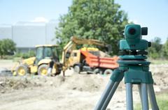 Surveying equipment to the construction site Stock Photos