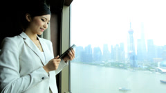 Successful Asian Chinese Businesswoman Penthouse View Accommodation Tablet - stock footage