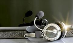 Headphones on notebook background Stock Photos