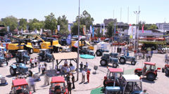 Agricultural Tractor fair time lapse Stock Footage