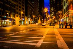 an intersection at night in baltimore, maryland. - stock photo