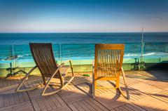 Chairs on a balcony overlooking the atlantic ocean at revel hotel casino in a Stock Photos