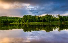 Evening reflections in the delaware river, at delaware water gap national rec Stock Photos