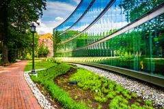 Garden and modern building at john hopkins university in baltimore, maryland. Stock Photos