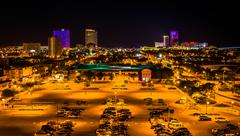 Streets and distant casinos at night in atlantic city, new jersey. Kuvituskuvat